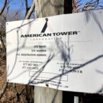 Identification sign posted on the gate to this American Tower structure in Corbin, Virginia
